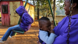 Children play at Nkosi's Haven where dozens of mothers and children affected by HIV and AIDS stay on Wednesday July 13, 2016. (AP /Denis Farrell)