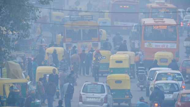 There are nearly 10 million vehicles on Delhi's roads. (AFP PHOTO/Chandan Khanna)