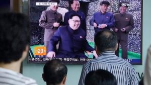 People watch a TV news program showing North Korean leader Kim Jong Un, at Seoul Railway station in Seoul, South Korea, Saturday, July 9, 2016. (AP Photo/Ahn Young-joon)