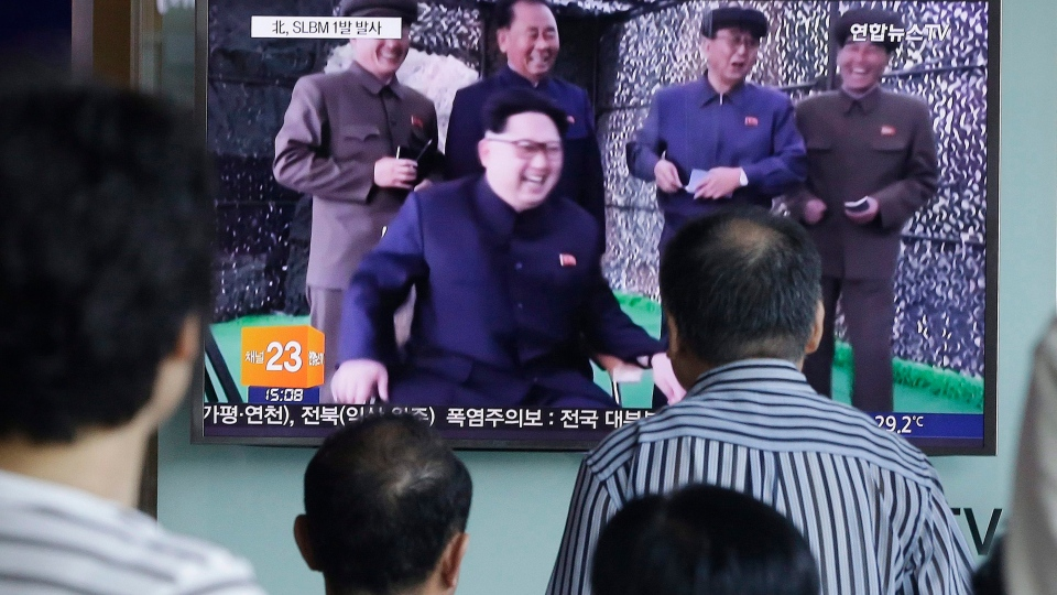 People watch a TV news program showing North Korean leader Kim Jong Un, at Seoul Railway station in Seoul, South Korea, Saturday, July 9, 2016. (AP / Ahn Young-joon)