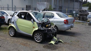 Chris Markevich's damaged Smart car is seen at a towing company in Campbell River. (Chris Markevich)