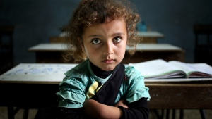 A Syrian refugee girl sits in a classroom at a Lebanese public school where only Syrian students attend classes in the afternoon, at Kaitaa village in north Lebanon on Thursday, May 29, 2014. (AP / Hussein Malla)