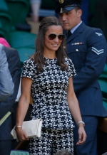 Pippa Middleton, the sister of Kate, the Duchess of Cambridge takes her seat in the Royal Box on Centre Court, ahead of the women's semifinal matches, at the All England Lawn Tennis Championships in Wimbledon, London on Thursday July 9, 2015. (AP / Alastair Grant)