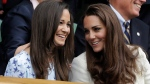 Kate, Duchess of Cambridge, right, speaks with her sister Pippa Middleton at the All England Lawn Tennis Championships at Wimbledon, England, Sunday, July 8, 2012. (AP / Kirsty Wigglesworth)