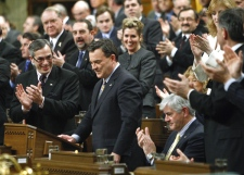 Finance Minister Jim Flaherty gets an ovation from fellow Conservative MPs as he tables the federal budget in the House of Commons on Parliament Hill in Ottawa Tuesday, Jan. 27, 2009. (Tom Hanson / THE CANADIAN PRESS)