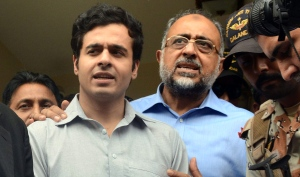 Awais Shah, center left, speaks to journalists with his father Sajjad Ali Shah, center right, chief justice of Sindh's High Court, after the son was rescued from kidnappers, in Karachi, Pakistan, Tuesday, July 19, 2016 (AP Photo/Imran Ali)