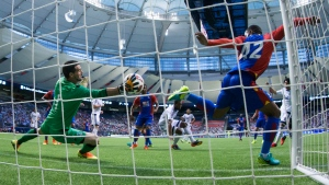 Crystal Palace goalkeeper Julian Speroni, left, stops Vancouver Whitecaps' Masato Kudo, back right, of Japan, as Palace's Jason Puncheon, right, defends during the second half of an international friendly soccer game in Vancouver, B.C., on Tuesday July 19, 2016. (Darryl Dyck / THE CANADIAN PRESS)