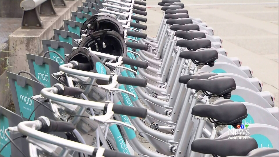 Mobi bikes are seen in a line.