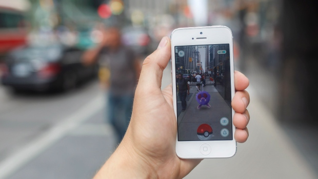 A Pokemon appears on a smartphone playing Pokemon Go in downtown Toronto, Ontario on Tuesday, July 19, 2016. (Cole Burston/The Canadian Press)