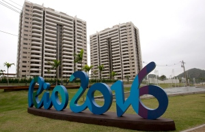 The Rio 2016 sign stands in front of the Olympic Village during a media tour in Rio de Janeiro, Brazil, Thursday, June 23, 2016. (AP Photo/Silvia Izquierdo)