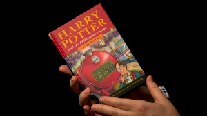 A first edition copy of the first Harry Potter book, 'Harry Potter and the Philosopher's Stone', containing annotations and illustrations by author J.K. Rowling is seen in London, Monday, May 20, 2013. (AP Photo / Matt Dunham)