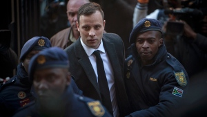 Oscar Pistorius, centre, arrives at the High Court in Pretoria, South Africa where he was sentenced to six years for the the killing of his girlfriend Reeve Steenkamp, July 6 2016. (AP / Shiraaz Mohamed)