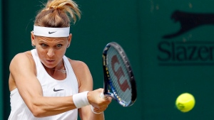 Lucie Safarova of the Czech Republic returns the ball during their women's singles match on day six of the Wimbledon Tennis Championships, in London, on Saturday, July 2, 2016. (AP Photo/Ben Curtis)