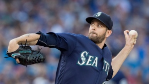 Seattle Mariners starting pitcher James Paxton throws against the Toronto Blue Jays during the first inning of their American League MLB baseball game in Toronto on Friday, July 22, 2016. THE CANADIAN PRESS/Fred Thornhill