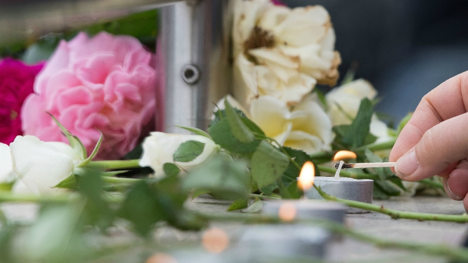 Candles are lit near a mall where a shooting took place leaving nine people dead the day before in Munich, Germany on Saturday, July 23, 2016. (AP / Sebastian Widmann)