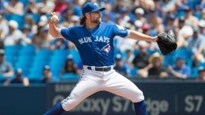 Toronto Blue Jays starting pitcher R.A. Dickey works against the Seattle Mariners during first inning American League MLB baseball action in Toronto on Saturday, July 23, 2016. (THE CANADIAN PRESS / Fred Thornhill)