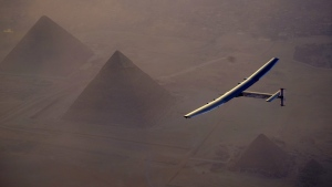 The Solar Impulse 2 flying over the pyramids, Egypt Cairo. The experimental solar-powered airplane has arrived in Egypt as part of its global voyage on July 13, 2016. (Jean Revillard, Rezo via the AP, File)