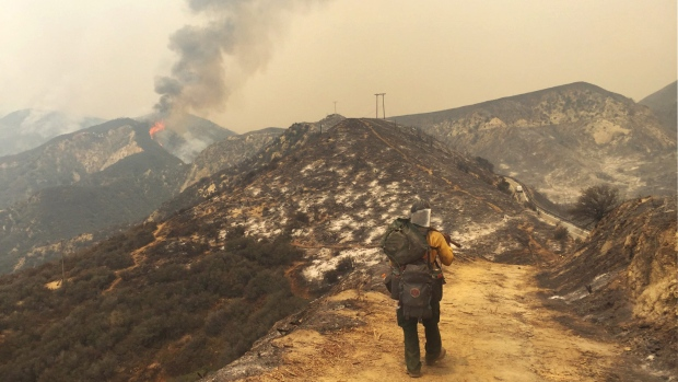 USDA Forest Service firefighter Simeon Hagens, with Angeles National Forest, packs out off of Little Tujunga Canyon Road in Santa Clarita, Calif., Saturday, July 23, 2016. (Katharine Lotze / The Santa Clarita Valley Signal via AP)