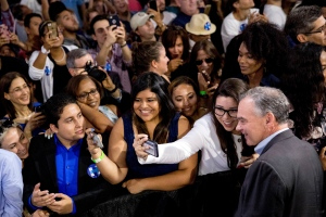 Sen. Tim Kaine, D-Va., right, take a photograph with a member of the audience after speaking at a rally with Democratic presidential candidate Hillary Clinton at Florida International University Panther Arena in Miami, Saturday, July 23, 2016. Clinton has chosen Kaine to be her running mate. (AP Photo/Andrew Harnik)