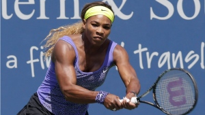 Serena Williams hits a backhand against Samatha Stosur, from Australia, during a match at the Western & Southern Open tennis tournament in Mason, Ohio on Aug. 13, 2014. (AP Photo/Al Behrman, File)