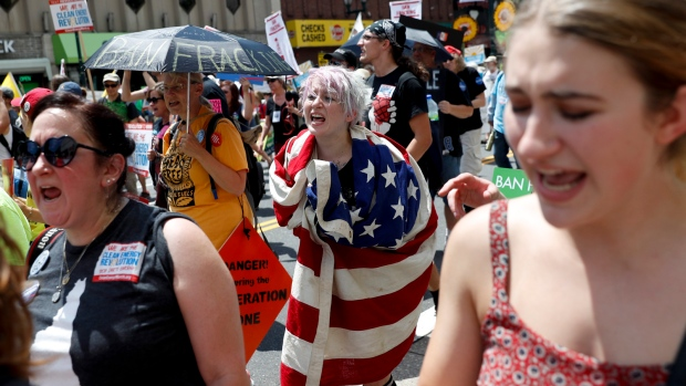 Protesters yell during a demonstration in downtown on Sunday, July 24, 2016, in Philadelphia. (AP / John Minchillo)
