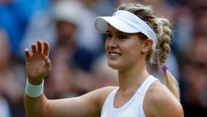 Eugenie Bouchard of Canada celebrates after beating Johanna Konta of Britain in their women's singles match on day four of the Wimbledon Tennis Championships in London on June 30, 2016. (THE CANADIAN PRESS/AP, Alastair Grant)