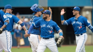 Toronto Blue Jays' Troy Tulowitzki, right to left, Kevin Pillar, Josh Thole and Josh Donaldson celebrate after defeating the Seattle Mariners in their American League MLB baseball game in Toronto Sunday July 24, 2016. (THE CANADIAN PRESS/Fred Thornhill)