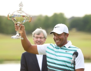 Jhonattan Vegas, of Venezuela, holds up the trophy as he celebrates winning the Canadian open golf tournament at Glen Abbey in Oakville, Ontario, on Sunday, July 24, 2016. (THE CANADIAN PRESS / Nathan Denette)