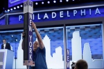 Jimmy Wright installs the New York delegation placard ahead of the 2016 Democratic National Convention in Philadelphia, Sunday, July 24, 2016. (AP / Matt Rourke)