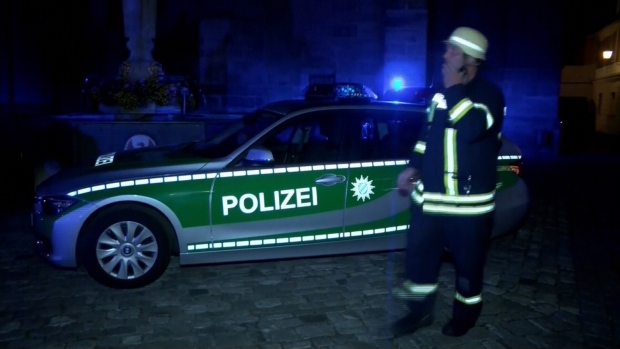 Emergency crews and officials asses the scene in Ansbach, Germany, after an explosion at a cafe. (Source: APTN)