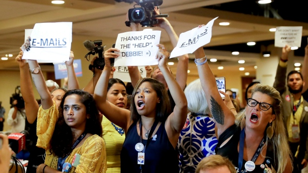 Protesters yell as DNC Chairwoman, Debbie Wasserman Schultz, D-Fla., arrives for a Florida delegation breakfast, Monday, July 25, 2016, in Philadelphia, during the first day of the Democratic National Convention. (AP Photo / Matt Slocum)