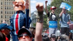 Bernie Sanders' supporters protest in Philadelphia, on July 24, 2016. (John Minchillo / AP)