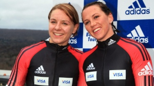 Canadian Bobsled Team brakeman Jaime Cruickshank (left) and driver Helen Upperton pose for photos after placing second at the World Cup Bobsled competition Saturday, December 16, 2006 in Lake Placid, N.Y. (AP Photo/Todd Bissonette)