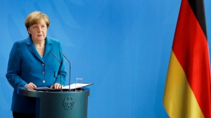 German Chancellor Angela Merkel addresses the nation after the Munich attack, in Berlin, Germany, on Saturday, July 23, 2016. (AP Photo/Michael Sohn)