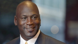 Former NBA star and current owner of the Charlotte Hornets, Michael Jordan, smiles at reporters in Chicago, on  Aug. 21, 2015. (AP Photo/Charles Rex Arbogast)