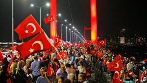 Pro-government supporters protest on Istanbul's iconic Bosporus Bridge, late on Thursday, July 21, 2016. (AP Photo/Emrah Gurel)
