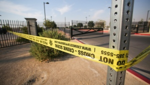 """Police tape hangs where police say a shooting erupted when a man in a vehicle attempted to rob a group of people playing """"Pokemon Go"""" in Las Vegas, on Monday, July 25, 2016. (Brett Le Blanc/Las Vegas Review-Journal via AP)"""
