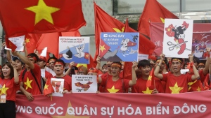 Vietnamese protesters hold their national flags and banners during a rally against China near the Chinese embassy in Seoul, South Korea on Sunday, July 24, 2016. (AP / Ahn Young-joon)