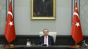 Under a portrait of Turkish Republic founder Mustafa Kemal Ataturk,Turkey's President Recep Tayyip Erdogan chairs the cabinet meeting, in Ankara, Turkey, Monday, July 25, 2016. (Presidential Press Service)