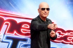 Howie Mandel arrives on the 'America's Got Talent' Season 11 Red Carpet at the Pasadena, Calif., Civic Auditorium in a March 3, 2016, file photo. (THE CANADIAN PRESS/AP-Invision, Rich Fury, File)