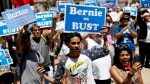 Supporters of Sen. Bernie Sanders, I-Vt., listens during a rally near City Hall in Philadelphia, Tuesday, July 26, 2016, during the second day of the Democratic National Convention. (AP Photo/John Minchillo)