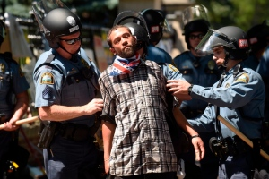 Joshua Lawrence is arrested by St. Paul police after protesters refused to move from in front of the Governor's residence on Summit Ave. in St. Paul, Minn. on Tuesday, July 26, 2016. (Scott Takushi / Pioneer Press via AP)
