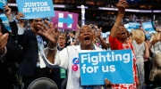 New York delegates cheer as they hold up signs during the second day session of the Democratic National Convention in Philadelphia, Tuesday, July 26, 2016. (AP / Carolyn Kaster)