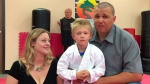 Liam Brenes, 4, with his parents, Amanda McFarland, and Frank Brenes at United Karate studio in Mission Viejo, Calif., on Tuesday, July 26, 2016. (Nick Koon / The Orange County Register)