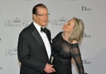 In this Sept.5, 2015, file photo, actor Roger Moore, left, and his wife Kristina Tholstrup pose on the red carpet as they arrive at the Monaco palace to attend the Princess Grace Foundation gala in Monaco. (AP Photo/Christian Alminana, File)