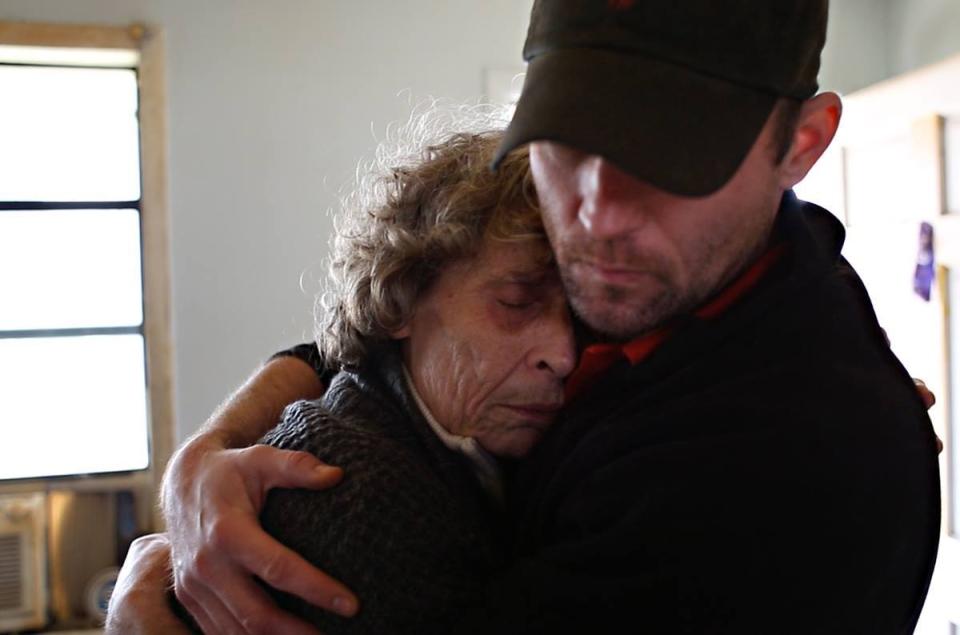 Cynthia Robinson gets a hug from her son, Seth. (photo courtesy Emily Robinson)