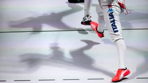 Shadows of Italy's Elisa Di Franciisca and Russia's Inna Derigazova at the fencing World championships in Moscow, Russia, on July 19, 2015. (Alexander Zemlianichenko / AP)