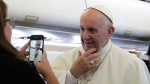 Pope Francis meets reporters during his flight to Poland, on July 27, 2016. (Gregorio Borgia / AP)