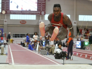 In this Saturday, Feb. 27, 2016 photo, Arkansas' Clive Pullen lands a jump in the men's triple jump at the Southeastern Conference Indoor Track and Field Championships in Fayetteville, Ark. (Michael Woods / The Arkansas Democrat-Gazette via AP)
