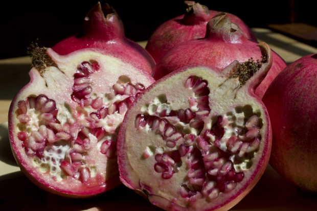 The ruby red fruit, which resembles a large apple but only its seeds are edible, is in season in September. (AP Photo/Larry Crowe)